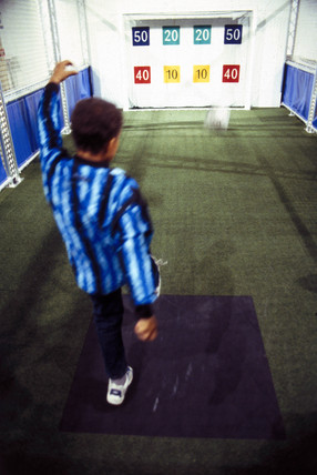 A boy playing football in a Science of Sport exhibit, 1997.