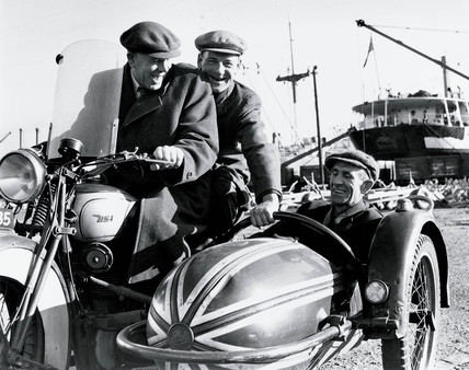 Fred, George and their companion riding a BSA motor-cycle combination, 1940.