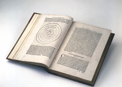 Open copy of  'On the Revolution of the Heavenly Spheres' 1543.