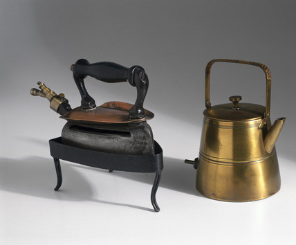 Bras electric kettle c 1910, and iron, c 1930.