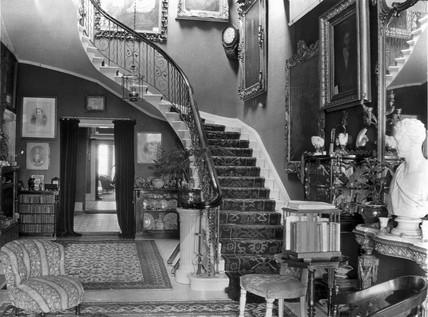 Edwardian hallway with staircase, c 1900s.