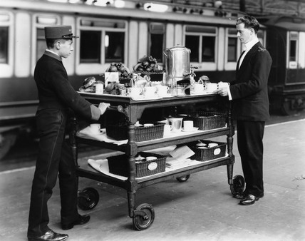 Two London and North Western Railway attendants with trolley, 1908.