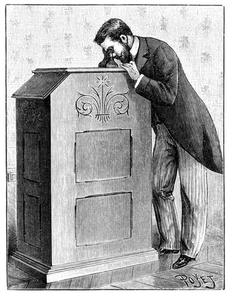 Man using an Edison Kinetoscope, c 1894.