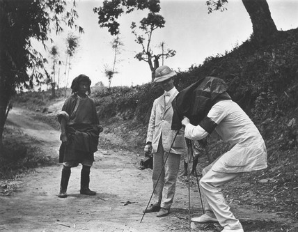 Two colonials taking a photograph of a 'native', c 1900s.
