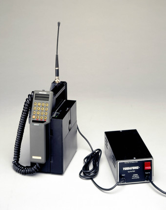 Vodafone transportable mobile phone with battery charger, 1985.
