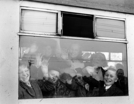 Pupils in the train waving through the window, June 1955.
