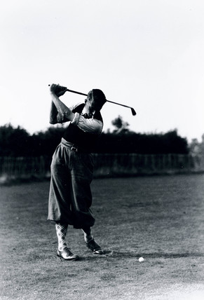 Smoking golfer caught in mid-swing, c 1930s