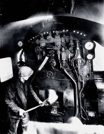 Fireraising on a clas 5 4-6-0 engine, 1936.