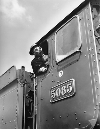 Railway worker wearing gas mask, 1939-1945.