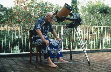 Arthur C Clarke using telescope, Sri Lanka.