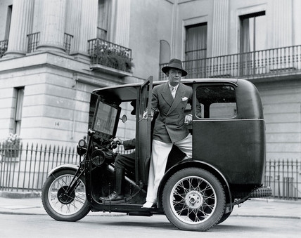 Man posing on a three-wheeler taxi, 27 June 1932.