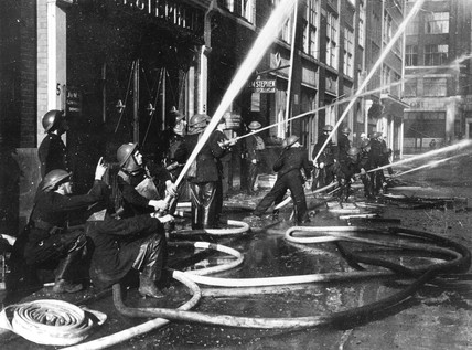 Firemen fighting a blaze caused by an air r