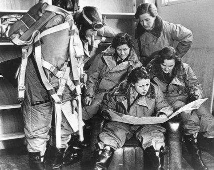 Women pilots reading a map, 10 January 1940