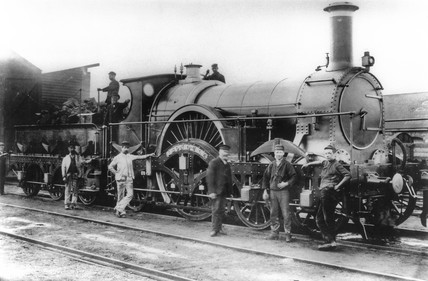 Iron Duke' steam locomotive with railway workers, c 1900s.