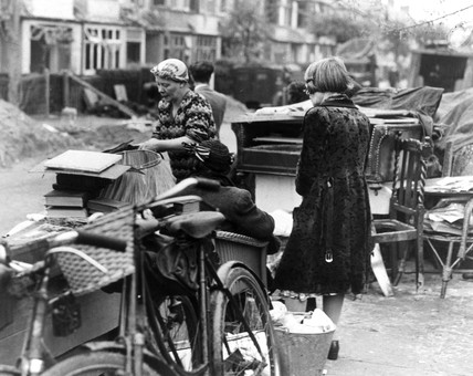 Women with their belongings after an air raid, 19 September 1944.
