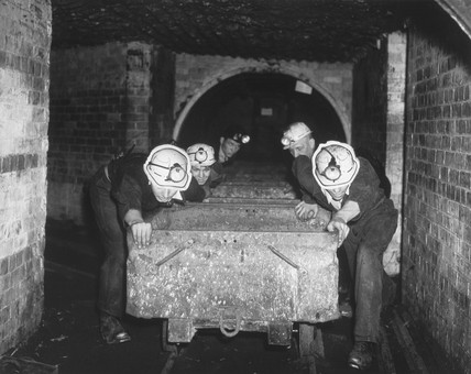 Trainee miners pushing wagons, 1 July 1954.