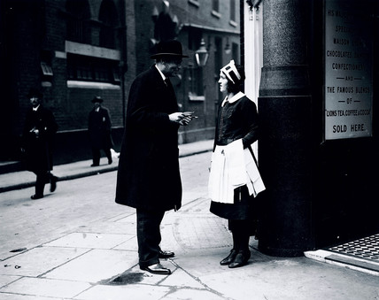 Reporter interviewing a waitres, 27 April 1931.