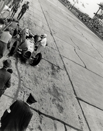 Auguste Momberger during a pit stop, German Grand Prix, Nurburgring, 1934.