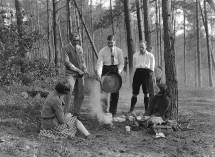 Campers cooking food, New Forest, England, 9 May 1931.