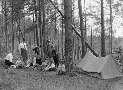 A group of campers cooking food, New Forest, England, 9 May 1931.