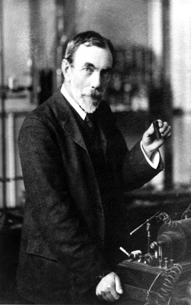 Sir William Ramsay holding a pocket spectrometer, c 1900.