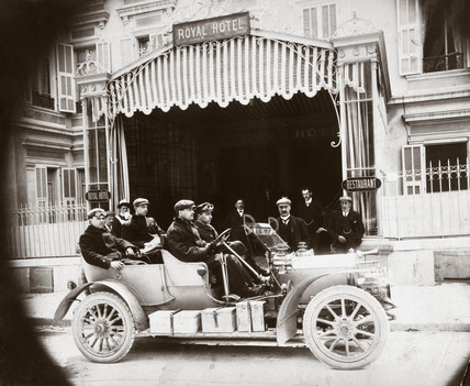 C S Rolls with friends in a Rolls-Royce car outside the Royal Hotel, 1904.