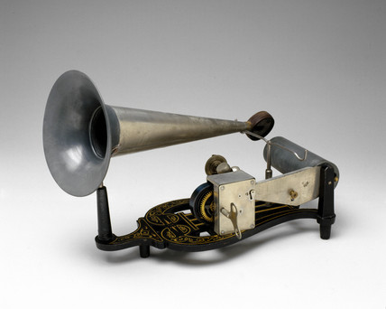 Puck phonograph with two records, c 1900.
