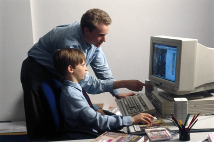 Child learning to use a computer, 1997.