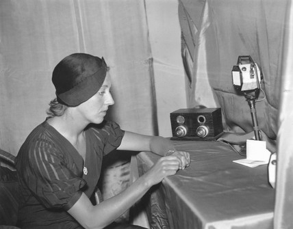 Amy Johnson making a broadcast from her hotel room, 18 December 1932.