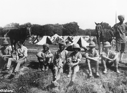 Canadian and Indian troops fraternising at