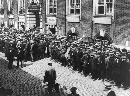 Men queuing outside a London recruitment of