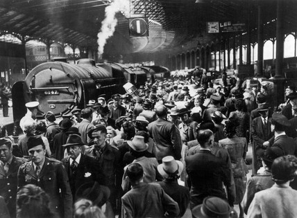 Crowds of holiday makers at Euston station, London, 1945.