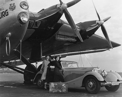 Two women beside a 500K Mercedes-Benz convertible, 1934-1935.