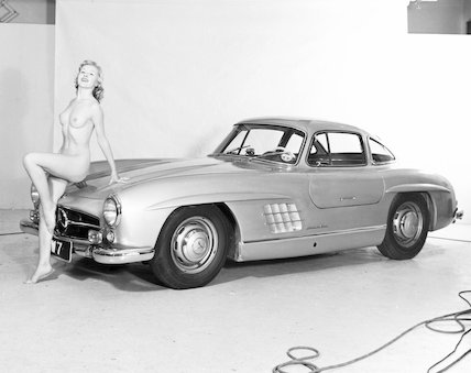 Nude model and Mercedes wing-door car, c 1961.
