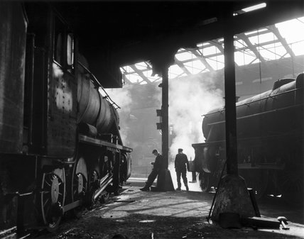 Grimy 8F and Clas 5 steam locomotives in a