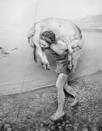 Prehistoric man carrying an animal which he