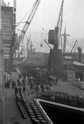 Workers unloading foodstuffs from boats, London, October 1931.