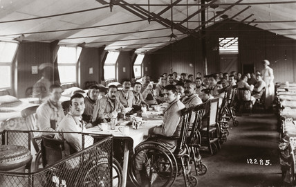 Nursing staff and wounded British soldiers in a hospital ward, c 1915-1918.
