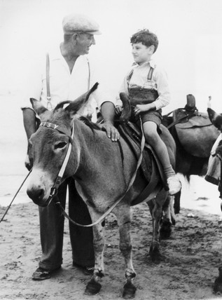 Donkey riding at Margate, Kent, 3 August 1949.