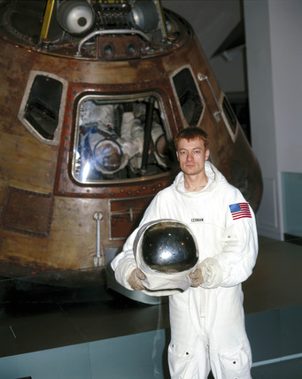 Actor dresed as an astronaut beside the Apollo 10 space module, 2001.
