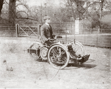 C S Rolls on a 4 hp Bollee Tri-Car, c 1898.