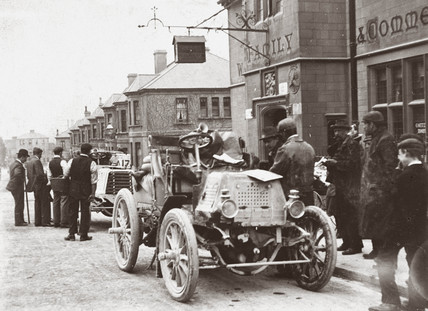 Motor car parked in a street during the 1000 Mile Trial, 1900.