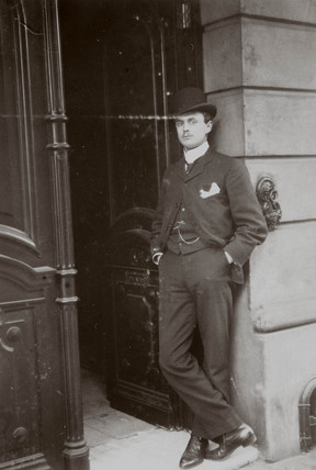 C S Rolls standing in a doorway wearing a bowler hat and suit, c 1902.