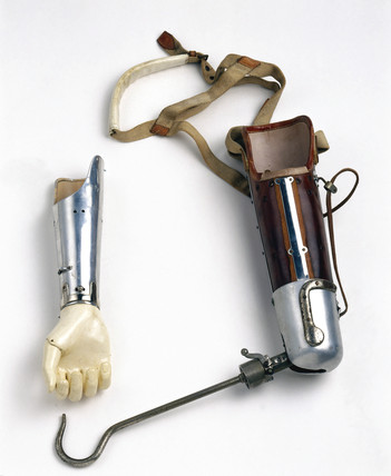 Artificial arm with hook and forearm attachments, c 1924-1930.