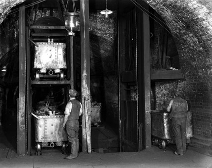 A cage at the bottom of a mine shaft, c 1890s.
