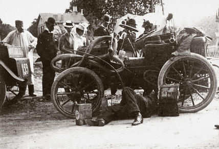 C S Rolls adjusting clutch prior to start of Paris-Boulogne Race, 1899.