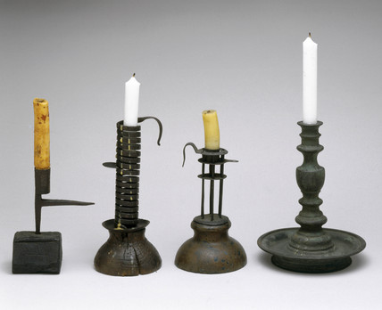 A selection of four candlesticks with candles, c 18th century .