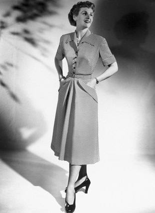 Woman wearing the latest fashions, 1940s.