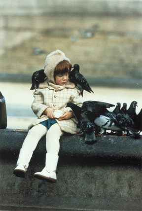 Little girl with pigeons, 1960s.
