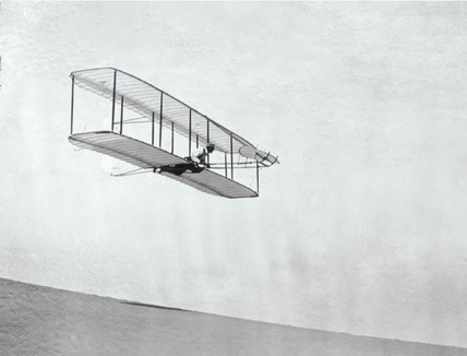 The Wright Brothers' modified third glider in flight, 1902.